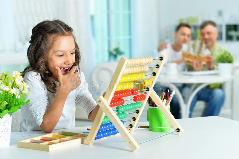 Portrait of cute little girl learning to use abacus royalty free stock image
