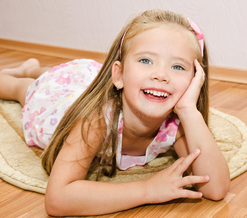 Download Cute Little Girl Lies On A House Floor Stock Image - Image of dream, smile: 33208355