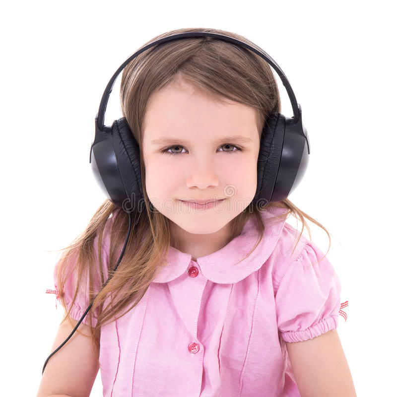 Cute little girl listening music in earphones isolated on white. Background stock photography