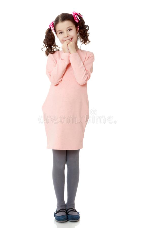 Shy girl holding hands near the face. royalty free stock image