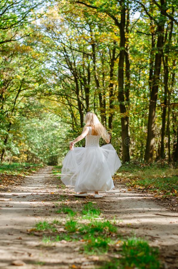 Happy girl in romantic forest royalty free stock photo