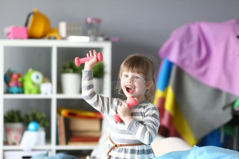 Cute little girl make physical exercises at home royalty free stock photo