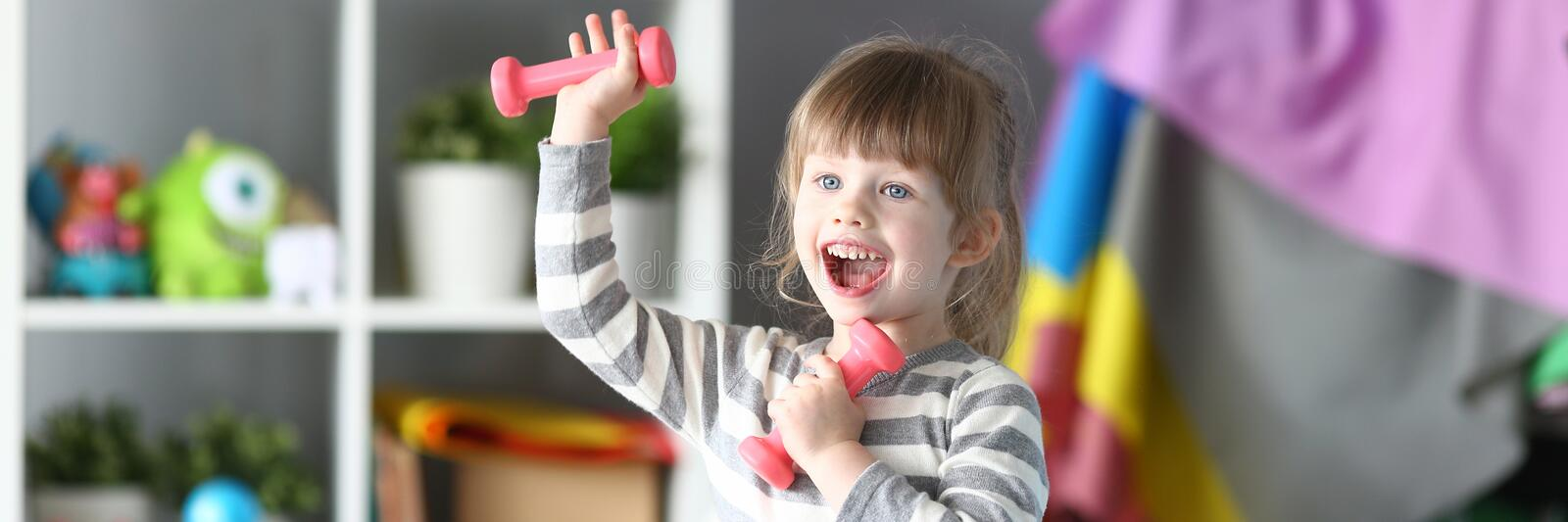 Cute little girl make physical exercises at home stock images