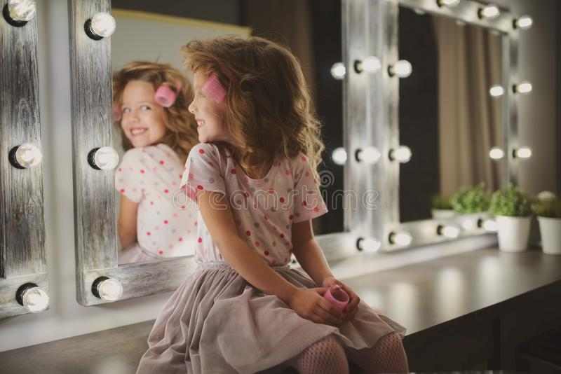 Cute little girl making make-up royalty free stock photo