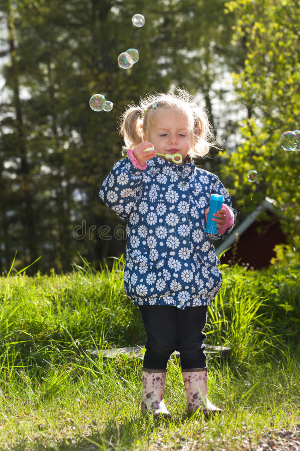 Download Cute Little Girl Making Soap Bubbles In Spring Stock Photo - Image: 30493072