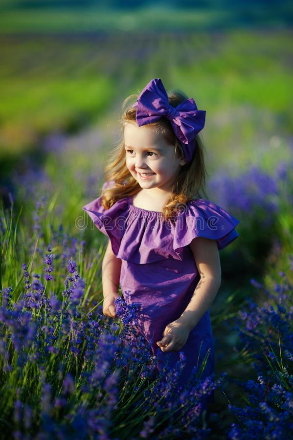 Cute little girl on the meadow in spring day. concept of childhood, health royalty free stock image