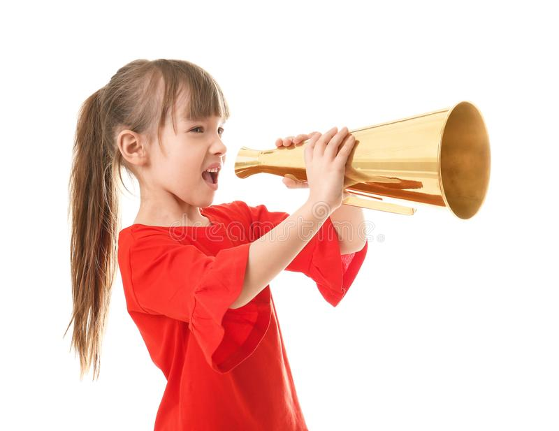 Cute little girl with megaphone. On white background stock photo