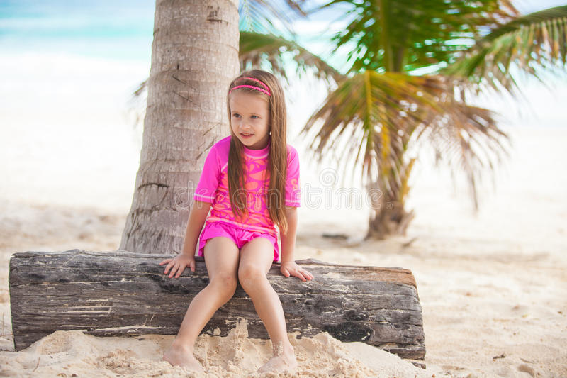 Cute little girl in nice swimsuits have fun at royalty free stock photography
