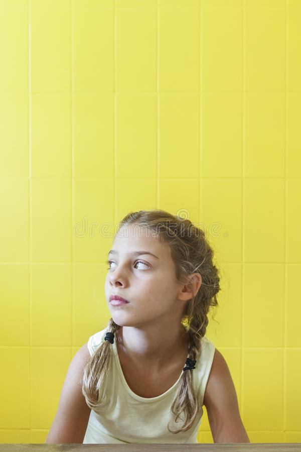 Free Cute Little Girl On Yellow Background With Braids Royalty Free Stock Photography - 143754417