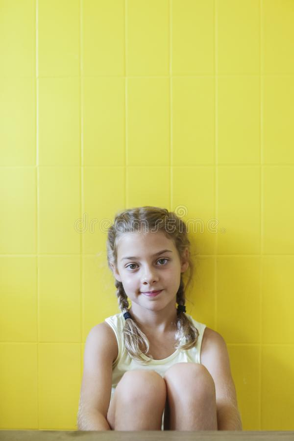 Free Cute Little Girl On Yellow Background With Braids Stock Photos - 143754633