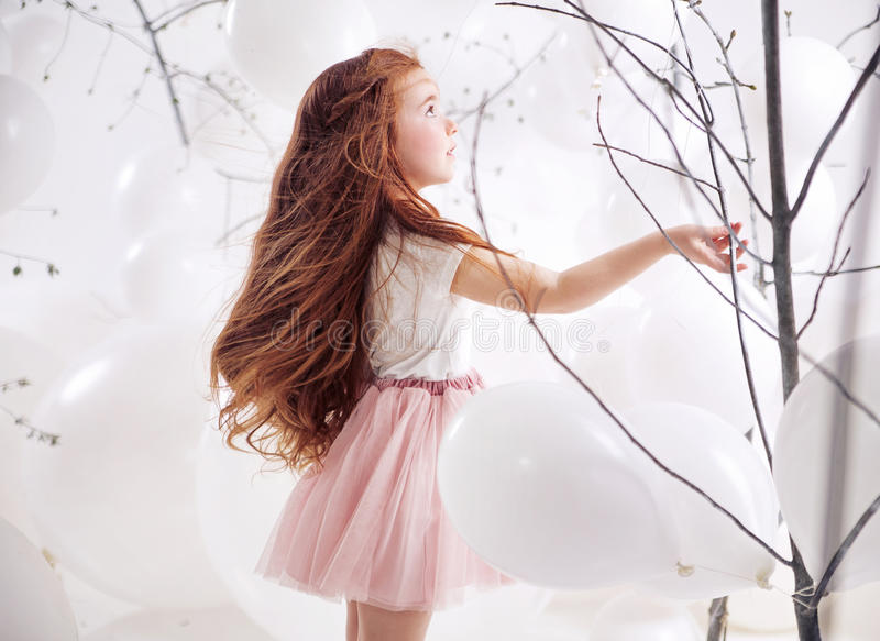 Cute little girl over the balloon background stock photography