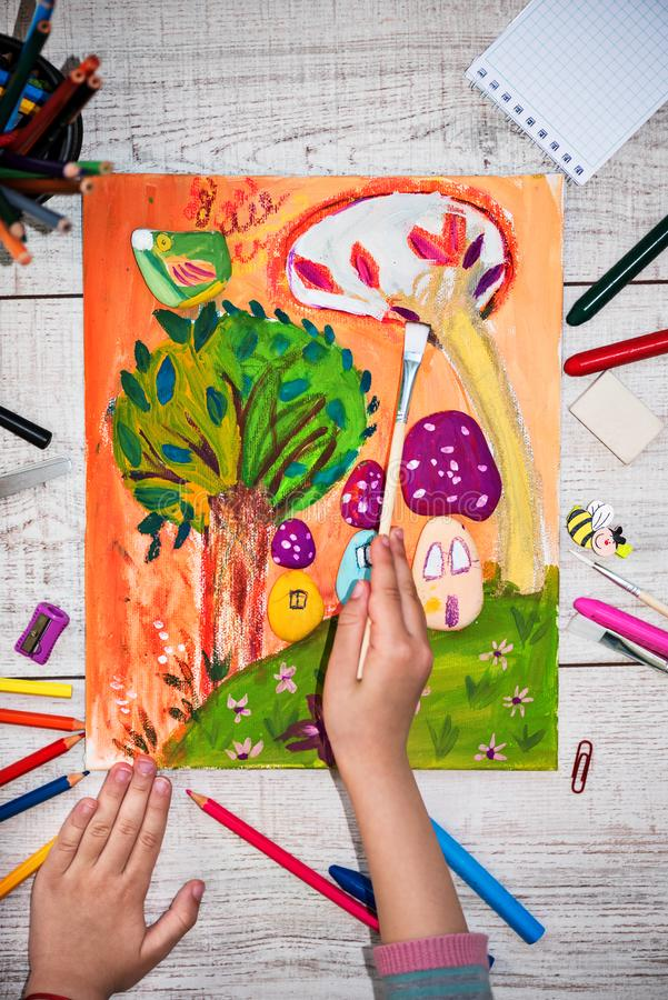 Cute little girl painting on canvas. Pain stock images
