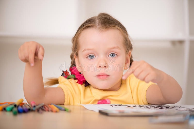 Cute little girl painting royalty free stock images