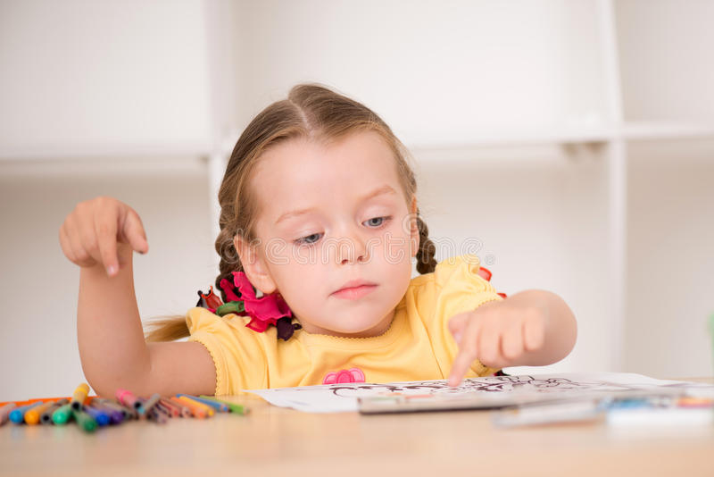 Download Cute little girl painting stock photo. Image of home - 43298620