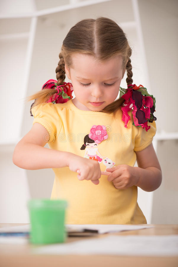 Download Cute little girl painting stock photo. Image of artist - 43298560