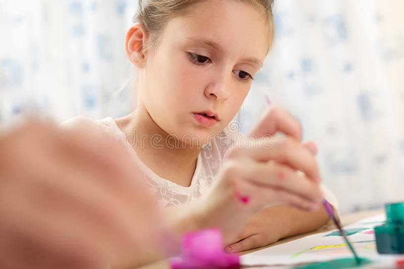 Cute little girl painting royalty free stock photos