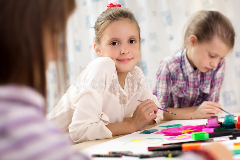 Cute little girl painting royalty free stock image