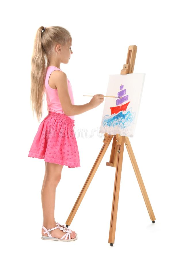 Cute little girl painting picture on canvas stock photo
