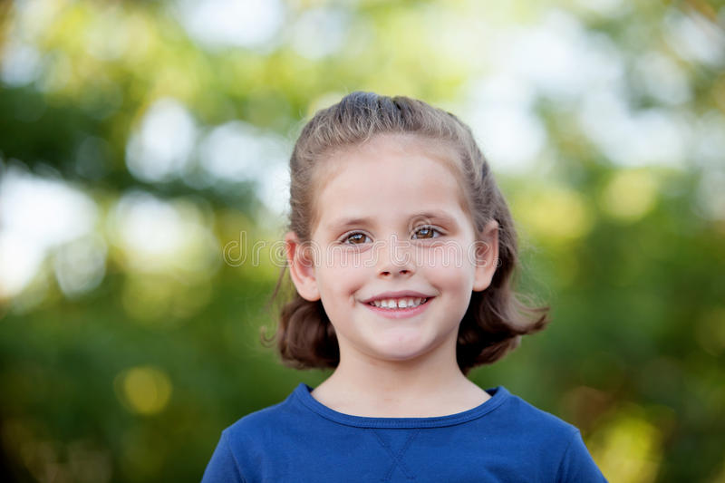 Cute little girl on the park royalty free stock images