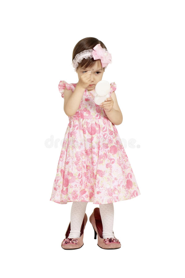Cute little girl in pink dress. Posing on white royalty free stock photography