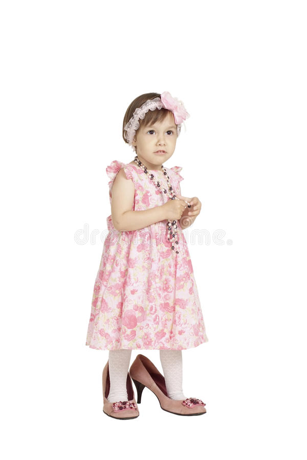 Cute little girl in pink dress. Posing on white stock photo