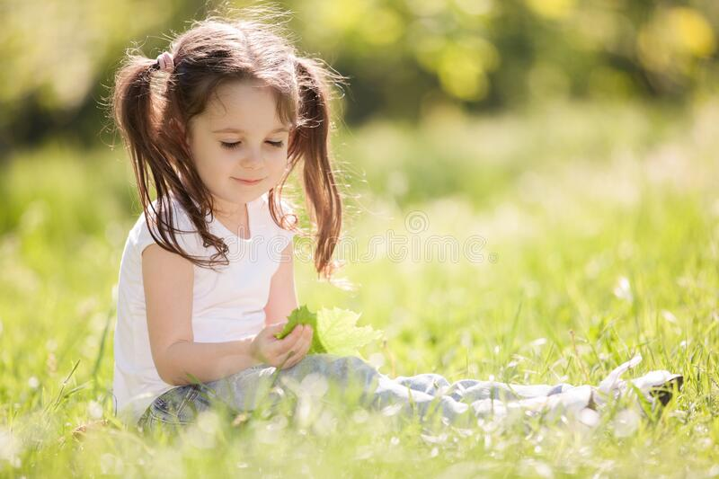 Cute little girl play in the park. Beauty nature scene with colorful background at summer or spring season. Family outdoor royalty free stock photos