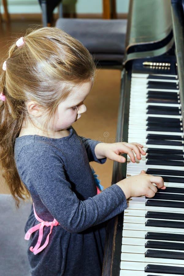 Nudist little girl playing piano girl rear