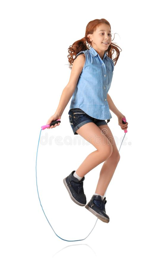 Cute little girl playing with jumping rope. On white background stock photos