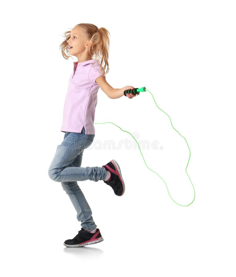 Cute little girl playing with jumping rope. On white background stock photography