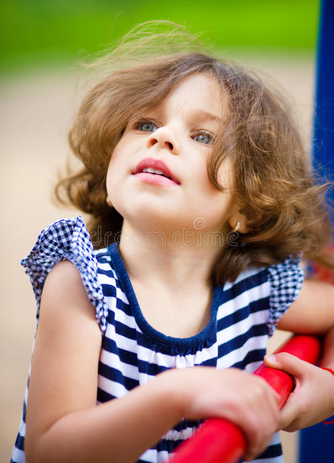 Cute little girl is playing in playground royalty free stock images