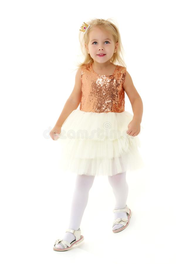 A little girl is photographed in the studio on a cyclorame. royalty free stock photos