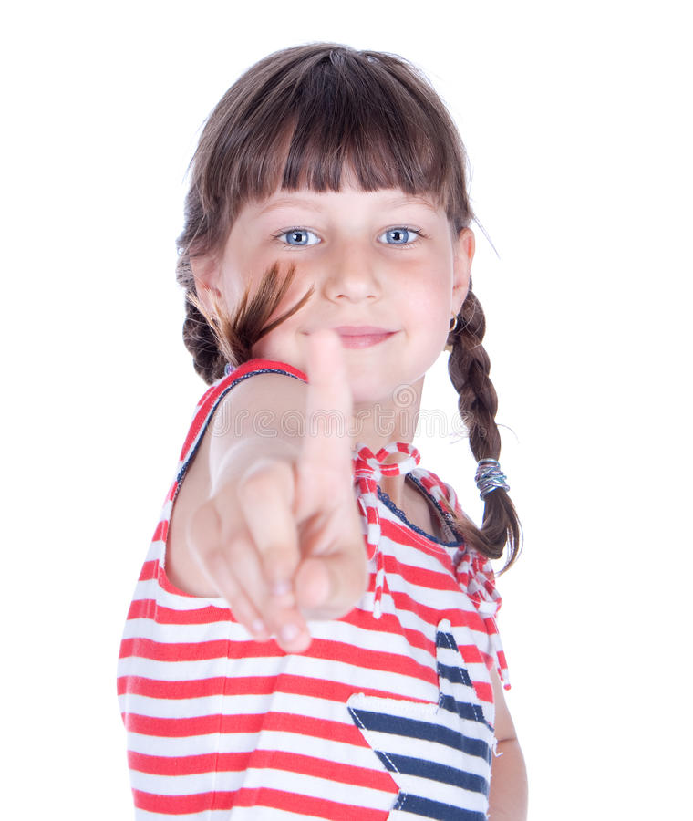 Cute little girl point her finger at someone. Studio shot royalty free stock photo