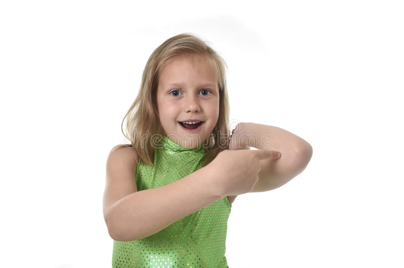 Cute little girl pointing her elbow in body parts learning school chart serie. 6 or 7 years old little girl with blond hair and blue eyes smiling happy posing royalty free stock image