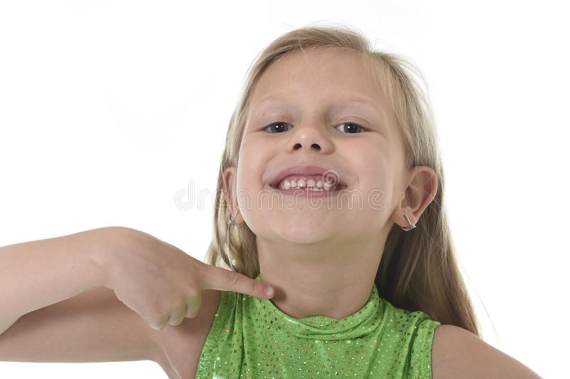 Cute little girl pointing her neck in body parts learning school chart serie royalty free stock photo