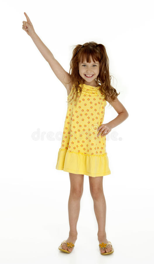 Cute Little Girl Pointing Upward royalty free stock images