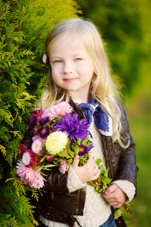 Cute little girl portrait on autumn day at city park stock images