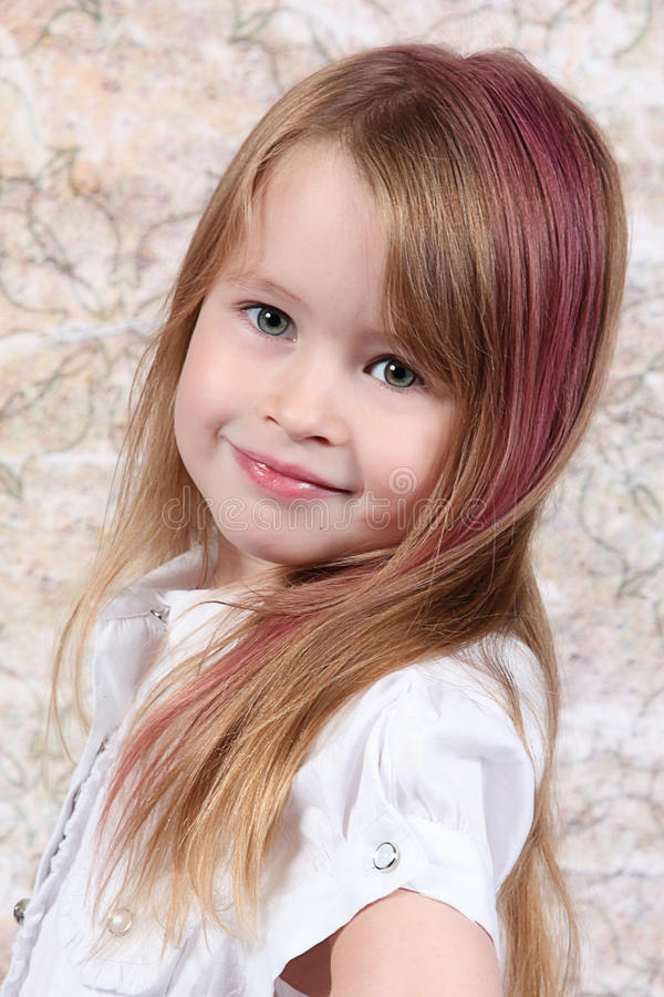 Cute little girl posing royalty free stock photography