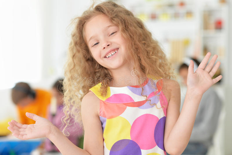 Cute little girl posing stock images