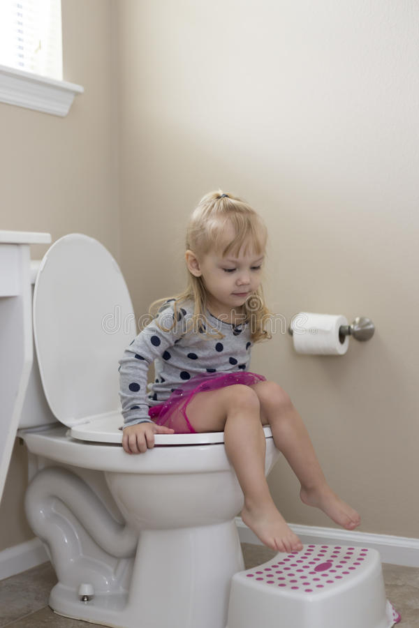 Cute Little Girl Potty Training Stock Photo - Image of ...