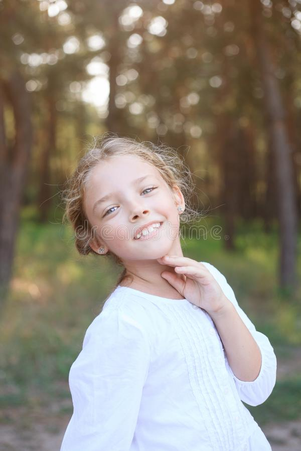 Cute little girl of preschool age in nature. Portrait with positive emotions. stock image