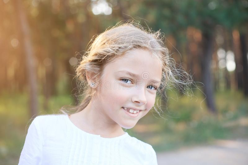 Cute little girl of preschool age in nature. Portrait with positive emotions. Happy summer day stock photos