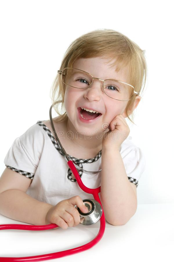 Cute little girl pretending to be a doctor stock photos