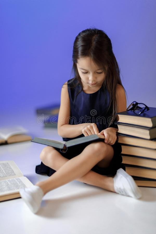 Cute little girl is reading a book. royalty free stock photos