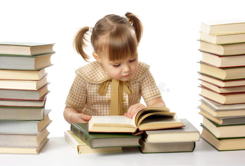Cute little girl reading books, back to school stock photos