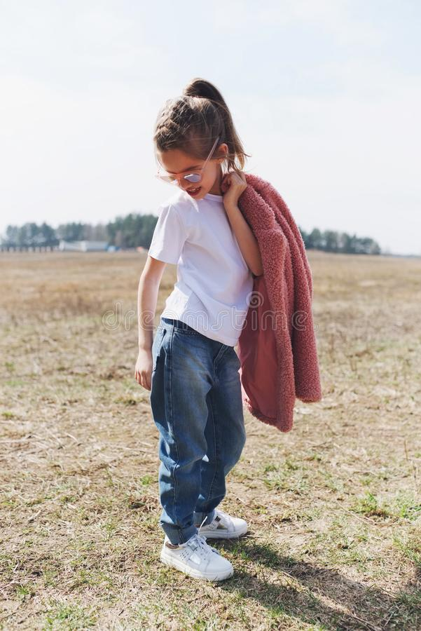 Cute little girl with red coat royalty free stock photo