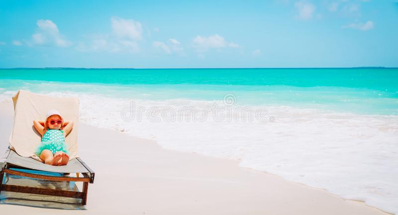 Cute little girl relaxed on summer beach royalty free stock photo