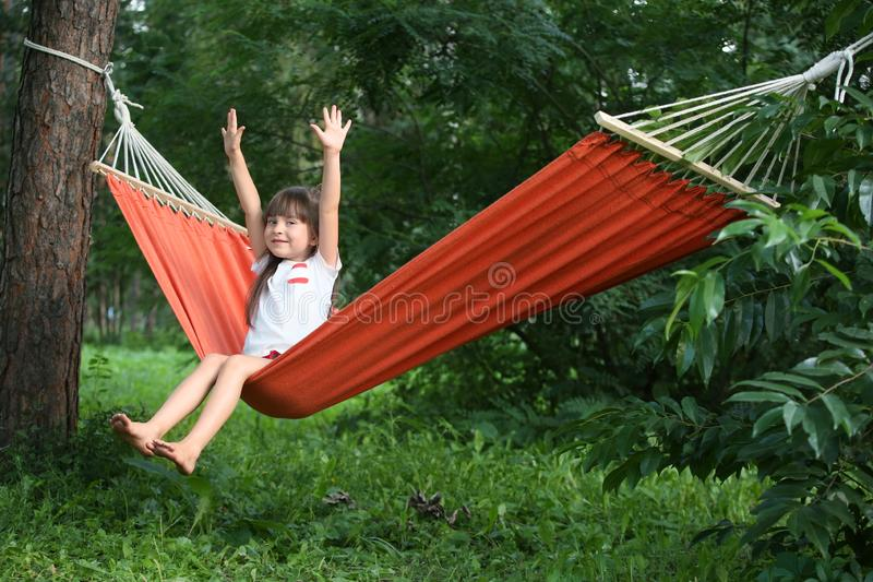 Cute little girl relaxing in hammock on summer day royalty free stock photos