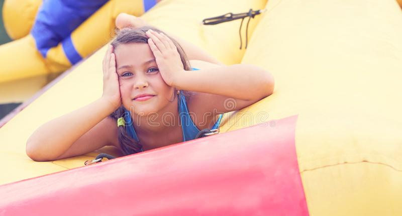 Cute little girl relaxing lying on inflatable mattress close-up portrait. royalty free stock photo