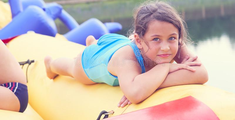 Cute little girl relaxing lying on inflatable mattress close-up portrait. stock images