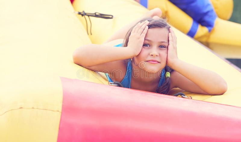 Cute little girl relaxing lying on inflatable mattress close-up portrait. royalty free stock images